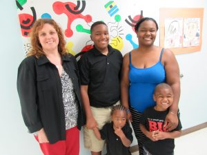 Pictured, SEH Program Manager, Christina Hewitt, with Amanda J. and family -- a participant in SEH.