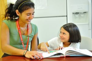 Marlena reading with a tutor
